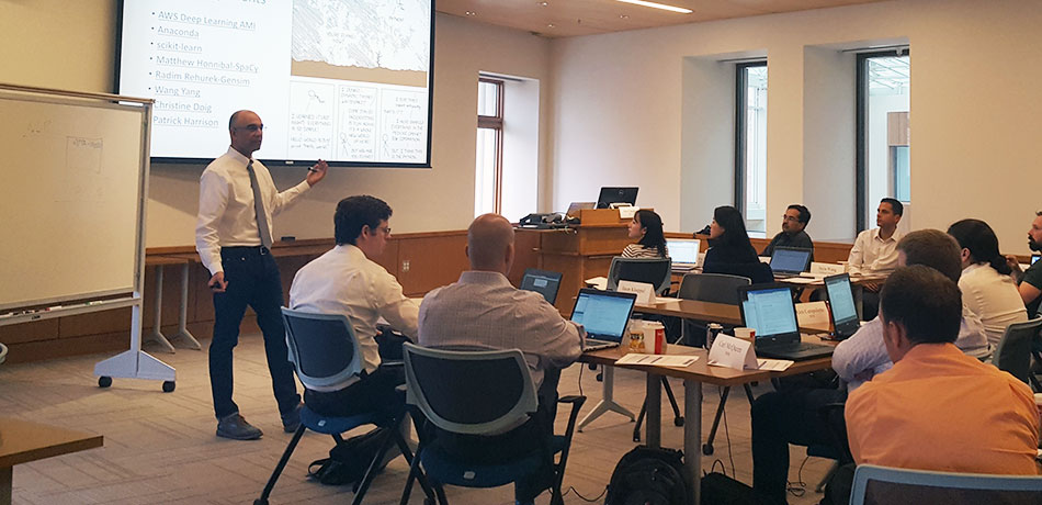 Participants hone technical expertise in immersion training seminars.