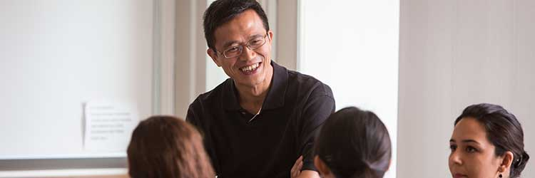 Professor Tat Chan teaches quantitative marketing students.