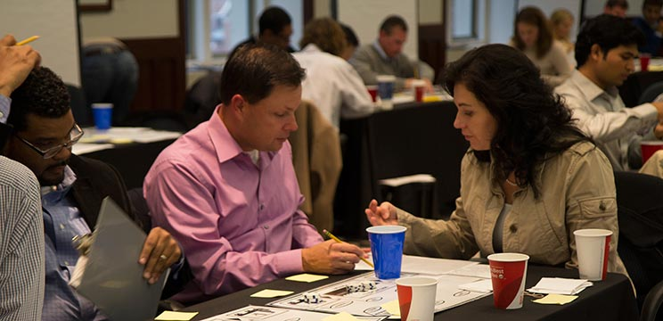 "Participants in Supply Chain Certificate play the ""Beer Game."""