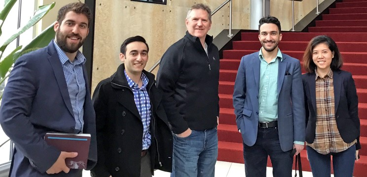 Student consulting team with John Shreve (center), senior principal with Populous, the world's largest stadium design firm.