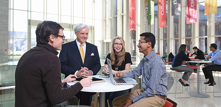 BSBA students converse with Dean Mark Taylor in the Atrium